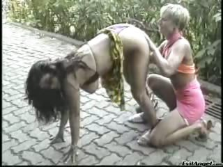 Porn Tube of Delicious Lesbians Eat Their Warm Pussies Into The Woods