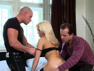gorgeous blonde bombshell rides on two cocks