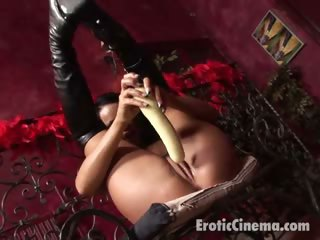 Porno Video of Awesome Brunette Harlot Fucking A Gigantic Dildo On The Couch