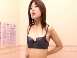 skinny asian girl is trying on underwear caught on hidden c