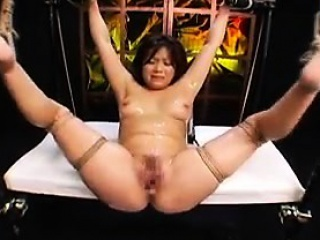 helpless asian beauty with big tits braces herself for a de