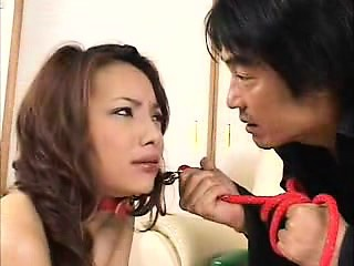 submissive oriental chick on a leash hangs on for an intens