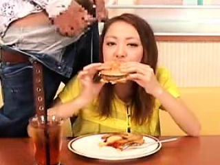 crazy asian chick is eating a meal that a dude jacks off in