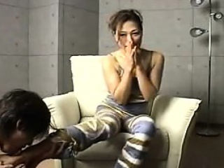 asian milf waits on the couch then gets fingered from behin