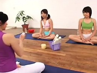 asian girls sit on a mat and then get a toy shoved up their