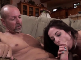 brunette milf gets naked and suck a fat dick in front of