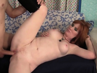 sexy redheaded milf gives her fuck buddy a nice blowjob and