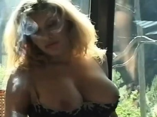 elegant chick in sexy lingerie likes to tease whilst smoking