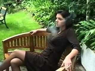 concupiscent slut smoking a cigarette and touching herself