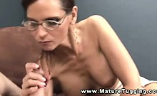 Busty mature in spex tugging on cock and cant get enough