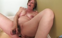 Horny housewife starts to masturbate her mature pussy on