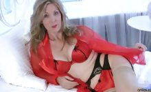 Sexy Milf Camilla strips in her bedroom and then