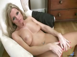 Porno Video of Blonde Housewife Rubs Lotion All Over Her Body Before Fingering Herself On The Livingroom Floor.