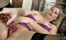Busty mature mom bares herself in lingerie and stockings