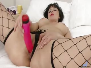 Porno Video of Amateur Cougar Turns On Her Seductive Charm As She Fondles Her Full Round Tits And Pumps Her Juicy Pussy With A Thick Vibrating Toy