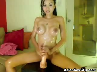 Porno Video of Oily Asian Hottie Riding A Fuck Machine