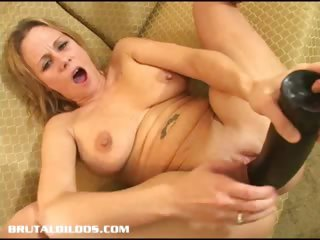 Porn Tube of Sunny Stuffs Her Pussy With A Huge Dildo