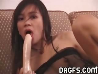 Porn Tube of Asian Slut Fucks A Huge Dildo On The Couch