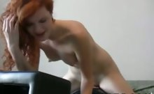 erotic red haired hooker rides a sybian in her bed