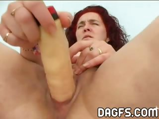 Porno Video of Red-haired Dumb Mom Fucks Herself With A Fake Plastic Penis