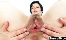 Busty mature lady Barbora spreads hairy pussy