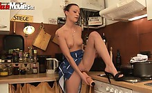 Kinky babe Jackie dildos her pussy in the kitchen