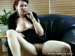 Porno Video of Brunette Babe Showing Her Big Boobs And Shaved Pussy While Smoking