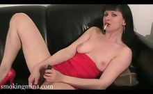 A hot girl smoking cigarettes rubs her pussy