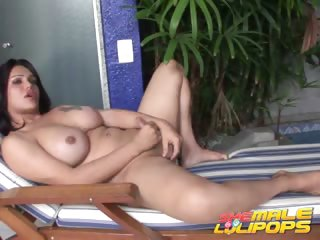 Porno Video of Busty Brunette She-male Penelope Jolie Masturbating Her Hard Cock At The Poolside
