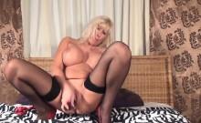 Blonde Mature masturbates with purple dildo