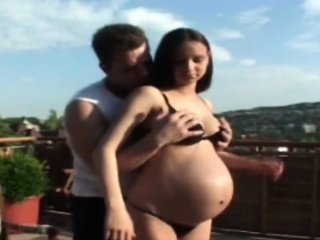 gorgeous young preggo is having incredible sex on balcony