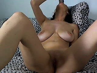 busty whore with erect nipples gives her man a blowjob