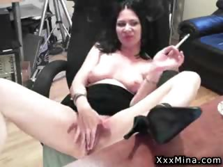 mature lady enjoys rubbing her pussy on the office chair